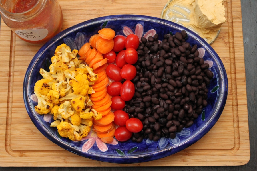 roasted cauliflower, carrots, tomatoes, black beans, salsa and cashew cheese