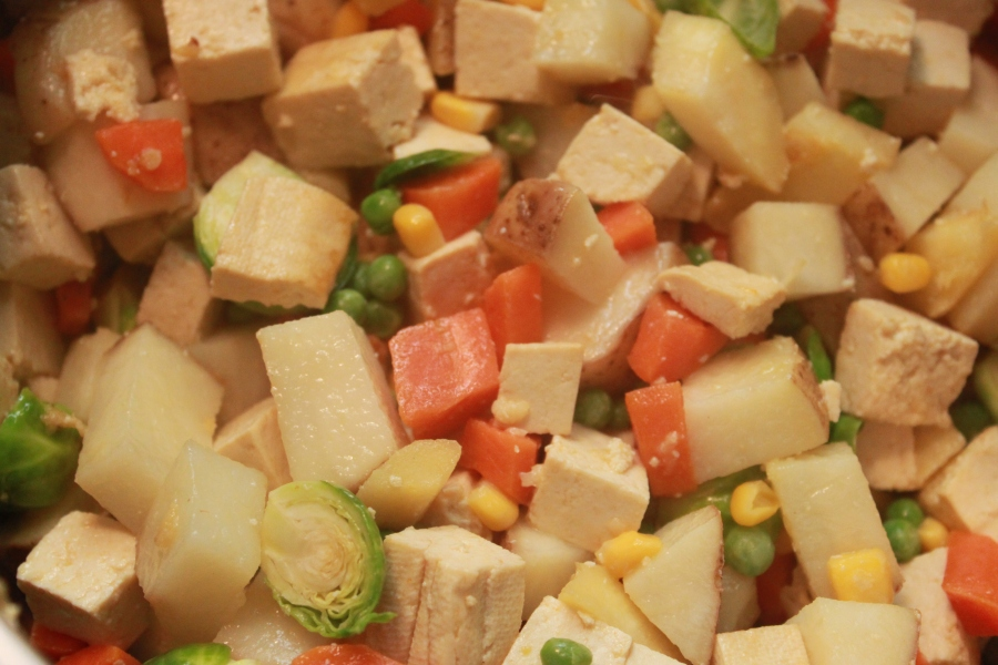 Potatoes, carrots, parsnips, brussels sprouts, tofu, peas and corn