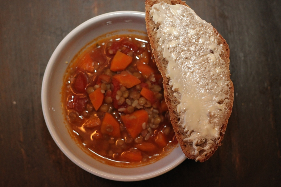 Hearty soup served with bread